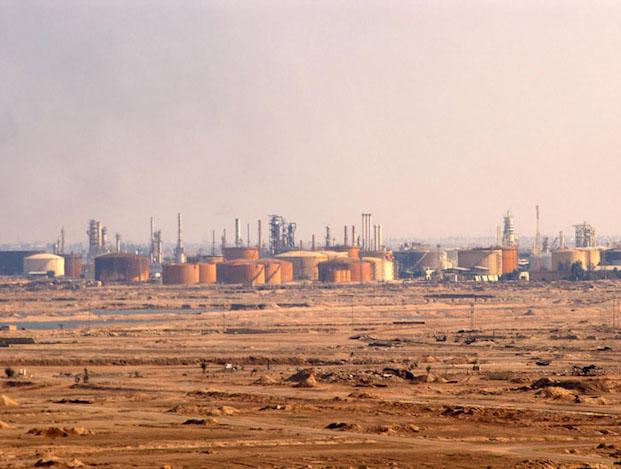 Oil down but OPEC+ member pledges on cuts cap losses